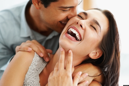 Closeup of beautiful young couple embracing and laughing; Shutterstock ID 69135130; PO: test; Job: dev; Client: drone