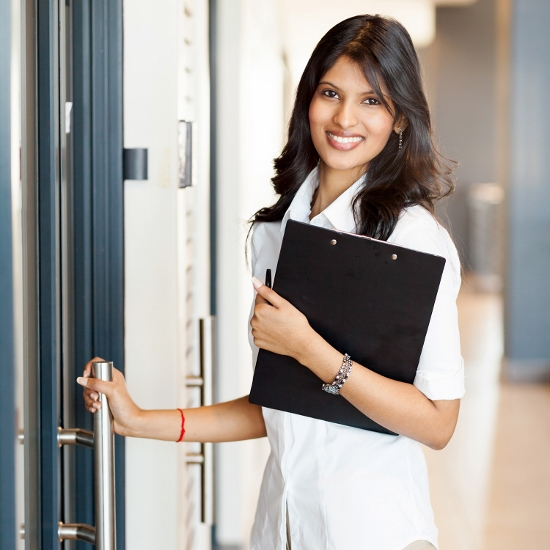 Businesswoman-opening-office-door (550x550)