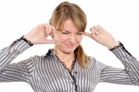 Woman-Covering-Ears-Credit-iStock-147309421 (550x366)